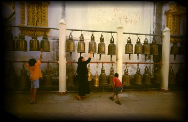 Ringing the bells for good luck in Chiang Mai, Thailand.